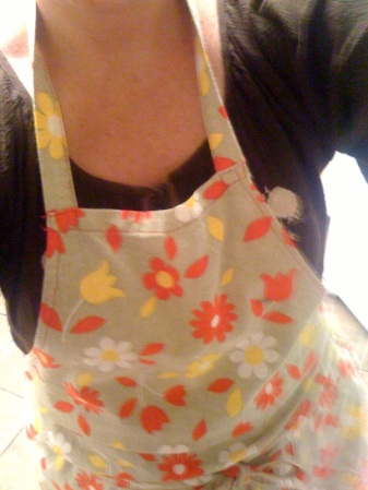 Isn't my apron cute? My sister and my teens got it at the estate sale of my dear neighbor, who has moved into a nursing home. The apron belonged to his wife. I love it!